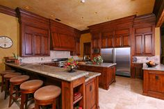 Mahogany kitchen cabinets. Design is too heavy for my space.