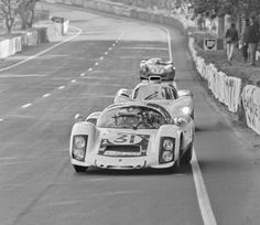 Hans Herrmann's Porsche 906 is being dogged by the Chaparral 2D at Le Mans, 1966. The 2D was considerably quicker than the 2 liter Porsche. Eric della Faille photo.