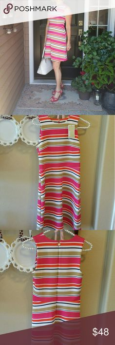 "NWT Michael Kors Orange, White & Tan Striped Dress This NWT Michael Kors Orange, White & Tan Striped Dress has a length of 35"" from the shoulder to the hem and a width of 16"" across from the bottom of the armholes. It's classic and timeless. Michael Kors Dresses"