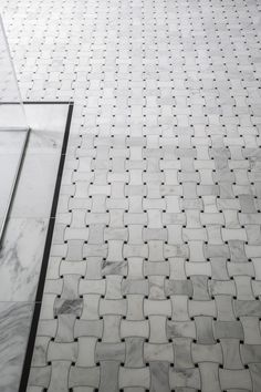 The basketweave tile pattern draws on the classic traditions of black and white mosaic tile in bathrooms, while keeping a contemporary feel. | Red House #bathroomtile #marbletile
