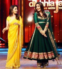 Madhuri Dixit in a yellow saree and Kareena Kapoor in a green anarkali