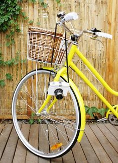 simple, yellow, old fashion bike with basket. sweet.