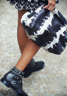 Elisabeth Weinstock oversized clutch and Saint Laurent studded combat boots..