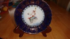 ANTIQUE HAND PAINTED PORCELAIN SAUCER GIRL WITH GRAPES  CARLSBAD AUSTRIA