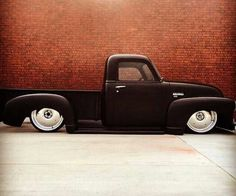 Chev Chevy Chevrolet advanced design pickup truck slammed over owl profile tires wrapped around solid billet wheels