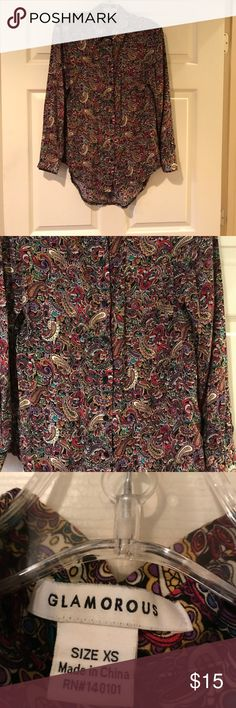 Multicolor paisley long sleeve high low shirt Beautiful vibrant jewel tones in this Paisley long sleeve shirt. You'll find pink, purple, teal, blue and yellow, over a black background. Glamorous brand purchased at Nordstrom. In very good used condition. glamorous Tops Blouses