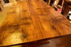 Two years ago our customers brought us a HUGE Oak log from their property. They wanted a Dining Room Table built out of it. The log had to dry for over a year. We sliced it up into thick slabs on our Sawmill and let it dry for another six months. This January we began to build their Dining Room Table. Every piece of this table is made from the tree on their property. We Finished it today....