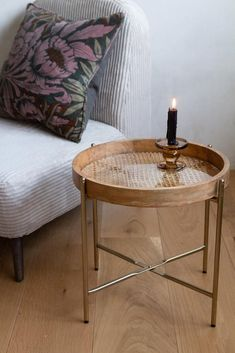 Lifestyle image of the Natural Wooden Rattan Side Table Rattan Bar Stools, Rattan Dining Chairs, Rattan Side Table, Cane Furniture, Rattan Furniture, Living Room Furniture, Wood And Metal Table, Metal Side Table, Side Tables