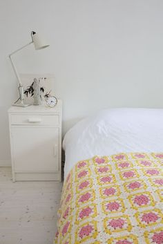Love the white accented with crochet blanket... #bedroom
