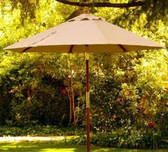 I love a Traditional Wooden Market Umbrella for the garden. #umbrella