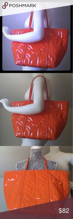 """DKNY Quilted Patent Leather Tote Glossy DKNY Quilted Logo patent leather design tote  -LARGE -GOOD CONDITION -some signs of wear like interior water stains & only a few tiny scruffs but not obvious & light pen marks in zipper pocket -PERFECT FOR SHOPPING,TRAVELING, VACATION,RUNNING ERRANDS or Just because you require a LARGE TOTE & LOVE ORANGE! -STURDY & STRONG BAG -UPPER WIDTH:19 INCHES-LOWER WIDTH: 12 INCHES-HEIGHT: 12 INCHES-SIDE WIDTH: 9 INCHES BASE: 8.5"""" -1 LARGE ZIPPER COMPARTMENT -2…"""