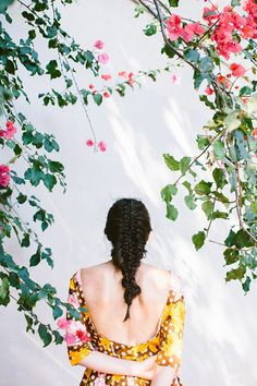 woman with braid and floral dress standing below bougainvillea photographed by luisa brimble / sfgirlbybay