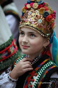 It is a picture of a girl in Ukraine wearing a traditional head dress.