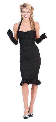 RITA+BLACK+VINTAGE+WIGGLE+DRESS+-+Beckoning+back+to+the+days+of+old+Hollywood+glamour,+the+Rita+wiggle+dress+will+have+you+feeling+like+a+movie+star.+This+sexy+little+number+will+have+you+wiggling+through+the+crowd+and+clearing+the+dance+floor.+Pinup+clothing+and+vintage+inspired+dresses+are+the+hottest+thing+in+fashion+because+they+will+never+go+out+of+style.Pair+this+dress+with+some+long+black+gloves+and+your+favorite+pair+of+shoes+and+get+ready+for+the+night+of+your+life.+MADE+IN+THE+USA…