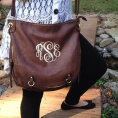 This Monogrammed  purse / Hobo bag is for the bigger purse lovers that cannot give up the feel of a cross body! This bag by I Flew The Nest is big enough for all the ladies and is super easy and fun to carry. The inside is delicately lined with this floral pattern and has one zipped pocket for your essentials. But that's not the only pocket this sneaky purse has….TALK ABOUT SECERT POCKETS as you can see in the second picture this hobo bag has TWO smaller pockets that are hidden in the seem…
