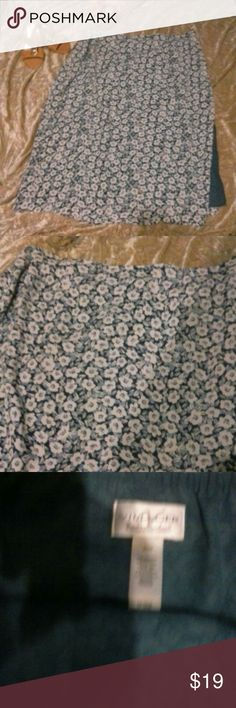 NWOT Villager Liz Claiborne Print Skirt Size 22W New without tags.Villager woman skirt a Liz Claiborne Co. It is in a small floral print Color beautiful understated royal blue background and white & blue flowers.  It is a  fully lined skirt in matching muted royal blue. Size hidden zippered closure and matching banded elastic waist in back. Machine washable and wrinkle free great summer skirt cool and comfortable!  Inv W1 Villager Woman Skirts Maxi