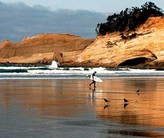 Surfing along the Pacific City beach in Oregon.