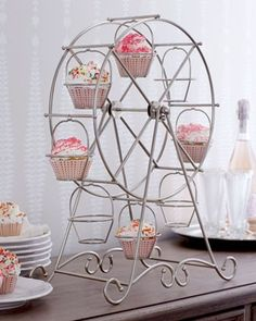 Ferris wheel cupcake holder *LOVE*....bridal party decor...and the bride gets to keep it for the kitchen..