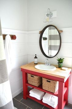 Curtain, red vanity, plank walls, mirror