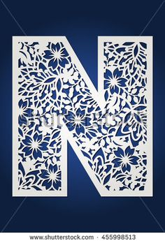 Floral laser cut monogram initial letter N with spring pattern.