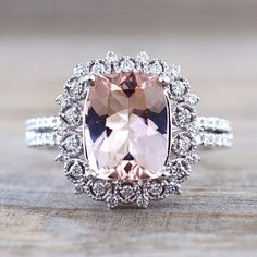 Cushion Cut Morganite set on a vintage inspired white gold diamond halo ring..