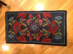 I don' t know the designer of this rug. I hooked in a class with Nola. Hooked by L. Boehle