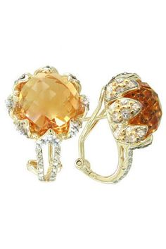 $119 A stunning combination with a perfect blend of Semi-Precious gems. 14K Gold over Sterling Silver with Omega back, the large Citrine is cradled by the delicate White Topaz.