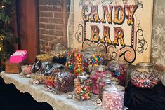 I really like the idea of a candy bar in lieu of favors guests just fill up a baggie of their favorite candy to take home.