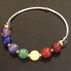 This is a wonderful Chakra Bracelet In Gold and Silver with Chakra Balancing Crystals. Chakra balancing crystals help to remind us to harmonize, balance and open the different chakra regions. 7 Chakra