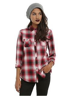 <p>A slightly different take on a classic woven top. Watch out traditionalists, we've thrown white into the plaid shirt to shake things up a bit. Long-sleeved button-up woven with a red, black and white plaid pattern, two front pockets and black button closure. </p> <ul> <li>60% cotton; 40% polyester</li> <li>Wash cold; dry low</li> <li>Imported</li> <li>Listed in junior sizes</li> </ul>