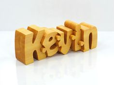 Personalized wooden name puzzle with one name. It is 100% hand made from one piece of solid pine wood. This is a perfect, unique and original gift