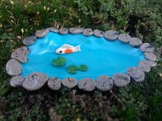 Our koi pond features a big fat koi and lily pads. Made entirely of polymer clay it is a bright blue to add a beautiful pop to your fairy garden. It is surrounded by polymer clay stones and is 5 inches long and 3 inches wide. It can be filled with water if you wish.