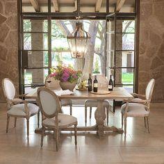 rustic dining room, large cowhide area rug, rustic wood floors