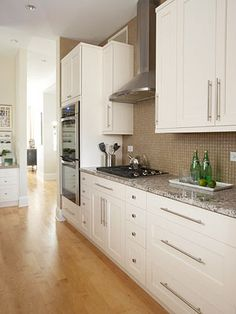 Contemporary Galley - I think we can add a double oven to the side where we currently have cabinets similar to this layout!