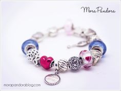 Pandora pink and blue bracelet, featuring the Valentine's 2016 Wild Hearts murano and the blue Cinderella muranos!