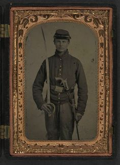 (c. 1861-1865) Soldier in Union artillery uniform with artillery saber and revolver