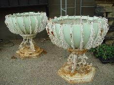 Victorian French cast iron urns...that green color is a giveaway...Detroit Garden Works