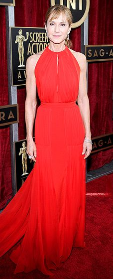 Holly Hunter: 2014 SAG Awards  The actress wore a sleeveless red halter gown with a keyhole slit to reveal some cleavage on the SAG Awards red carpet.  Read more: http://www.usmagazine.com/red-carpet/holly-hunter-2014-sag-awards-2014181#ixzz2qrRCmKEM