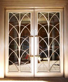 Art Deco doors dors for small wine cellar in dining room. have bronze doors