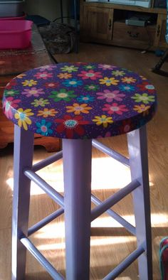 My first attempt at mod podge to fix up my old classroom stool.  97cent piece of fabric from walmart!