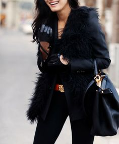 All black with red belt and gloves and fur vest
