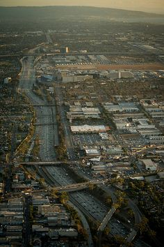 This aerial view from the Goodyear blimp shows the California route 405 freeway in the Los Angeles area with the space shuttle Endeavour next to the Randy's Donuts landmark in Inglewood, Calif., Friday, Oct. 12, 2012. Space Shuttle Endeavour Move (201210120015HQ)