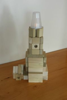 Light up their day! Give your kids a battery tea light to use when playing with blocks. Here's a project that's sure to shine!   Let your kids build this lighthouse from wooden building blocks. Find step by step instructions at http://backtoblocks.com/blog/backtoblocks_blog_kids_blocks_lighthouse/