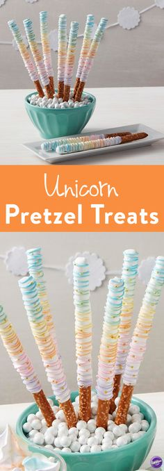Rainbow Unicorn Pretzel Treats - Wands and swords have nothing on these Candy Dipped Pretzel Rainbow Treats! Pretzel rods get a magical makeover with Candy Melts candy and Gold Stars Edible Accents. Perfect for princess parties and fairy tale themed birthdays, these colorful and sparkling rainbow desserts are a great way to keep kids fueled and entertained throughout the day.