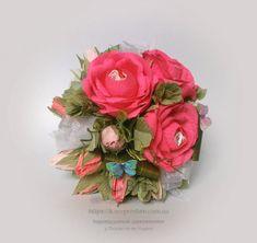 Рожеві троянди. В кожній квіточці цукерочки Raffaello та Трюфель АВК.