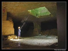 In the Caen stone quarries, Normandy France - the favoured white stone of William the Conqueror - used in the building of the White Tower of London 11th century,  (also used for Canterbury Cathedral, Westminster Abbey)