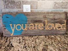 """Barn wood """"you are loved"""" sign"""