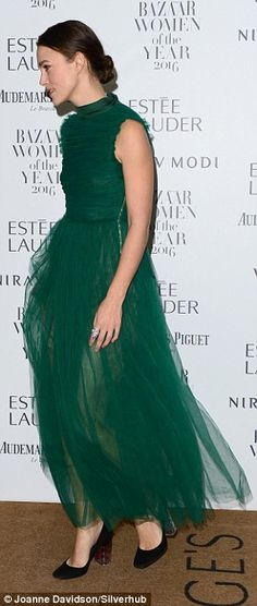 The 31-year-old Pride And Prejudice beauty opted for a bold emerald green gown comprising of layers of plush chiffon material gently skimming her trim physique