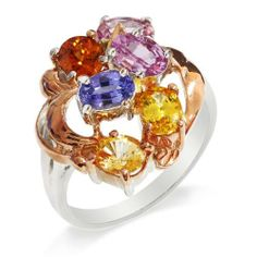 A fine piece of craftsmanship offered by LenYa, this ring features a beautiful collection of Sapphires and a single Hessonite. The design is distinctively floral in nature and the viewer will be taken by the random yet beautiful placement of Blue, Yellow and Pink Sapphires. The Pink Gold plating provides a fantastic background for the beautiful gemstones while the Rhodium plating on the Silver band gives the ring a gleam that cannot be matched by ordinary silver.