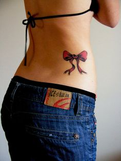 bow tattoo- i like the placement